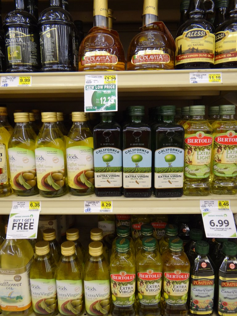 photo of olive oil on grocery store shelf