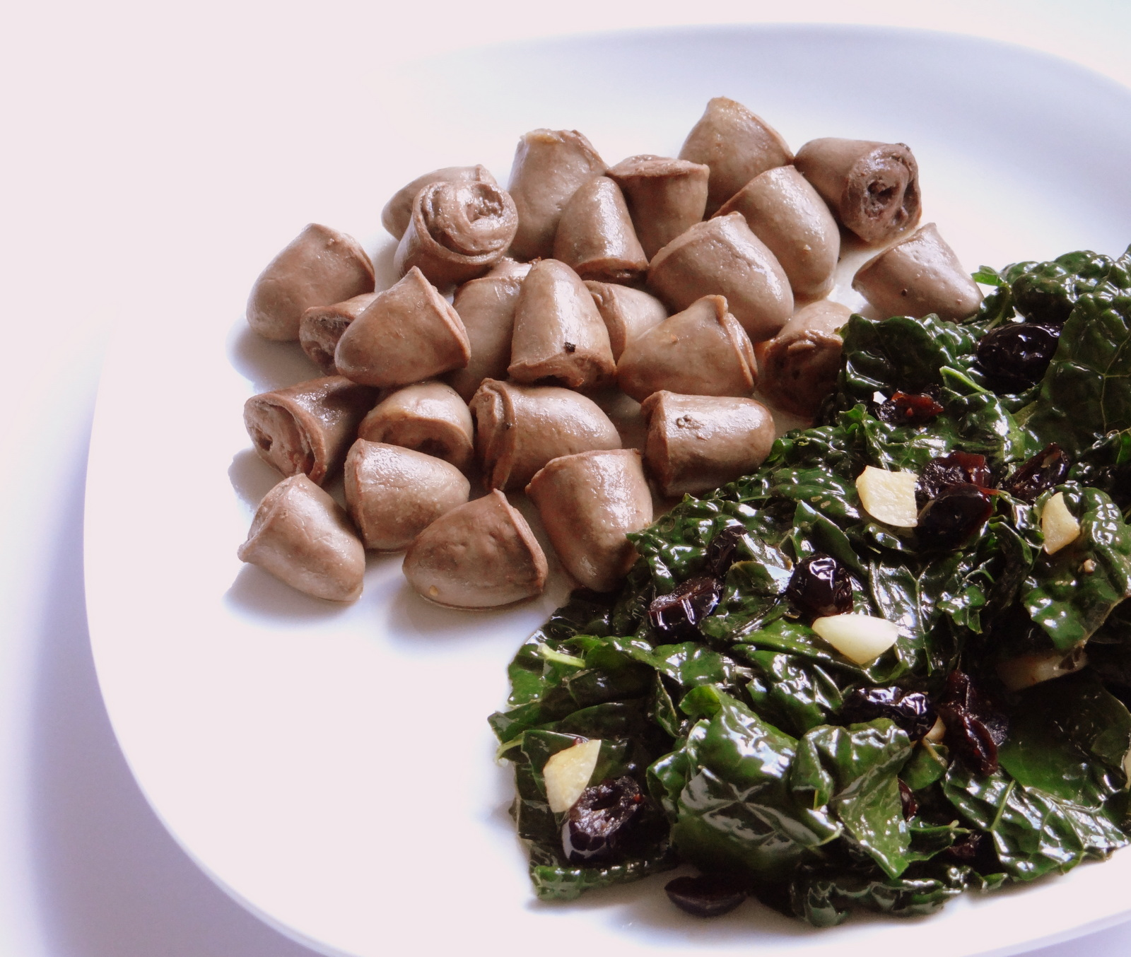 photo of chicken hearts & kale with cranberries